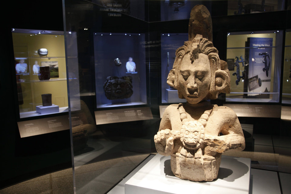 A stone figure of a Mayan god is shown at the Penn Museum in Philadelphia. AP photo