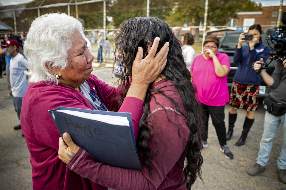 Photo - Tess Harjo, right, is embraced by her grandmother Sally Taylor after Harjo was released from the Dr. Eddie Warrior Correctional Facility on Monday, Nov. 4, 2019 in Taft, Okla. Governor Kevin Stitt greeted an estimated 70 women whose sentences he commuted from the facility. [Chris Landsberger/The Oklahoman]