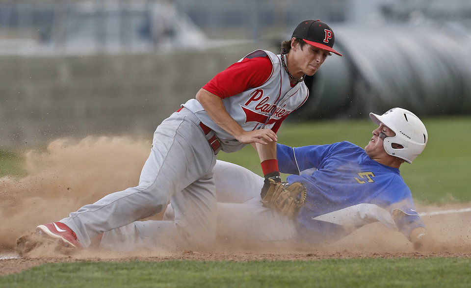 Berryhill's Nick White is out at third under Plainview's Newman Hoben in the first inning of the Class 4A state baseball tournament championship game in Shawnee, Okla., Saturday, May 11, 2013. Photo by Bryan Terry, The Oklahoman