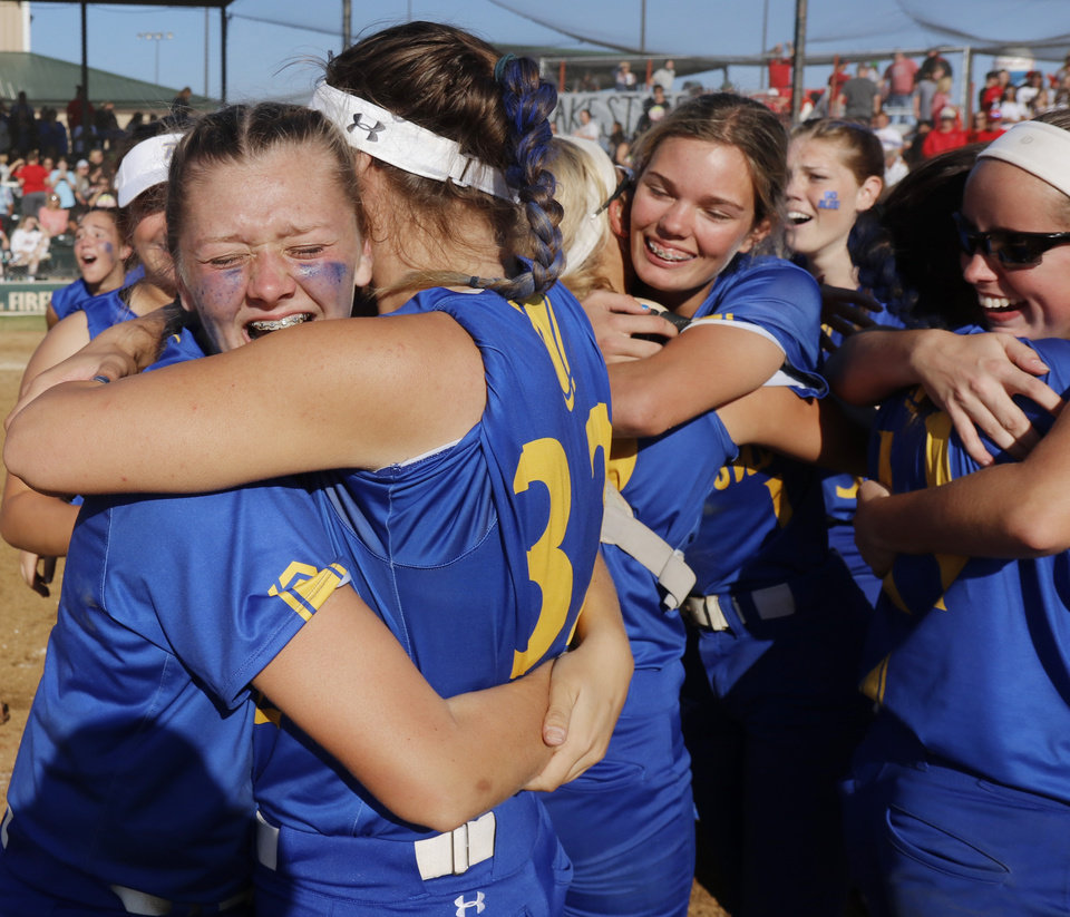Photo - Piedmont celebrates during the 5A Fast Pitch Championship game between Piedmont and Carl Albert at the Ball Fields at Firelake in Shawnee, Saturday, October 19, 2019. [Doug Hoke/The Oklahoman]