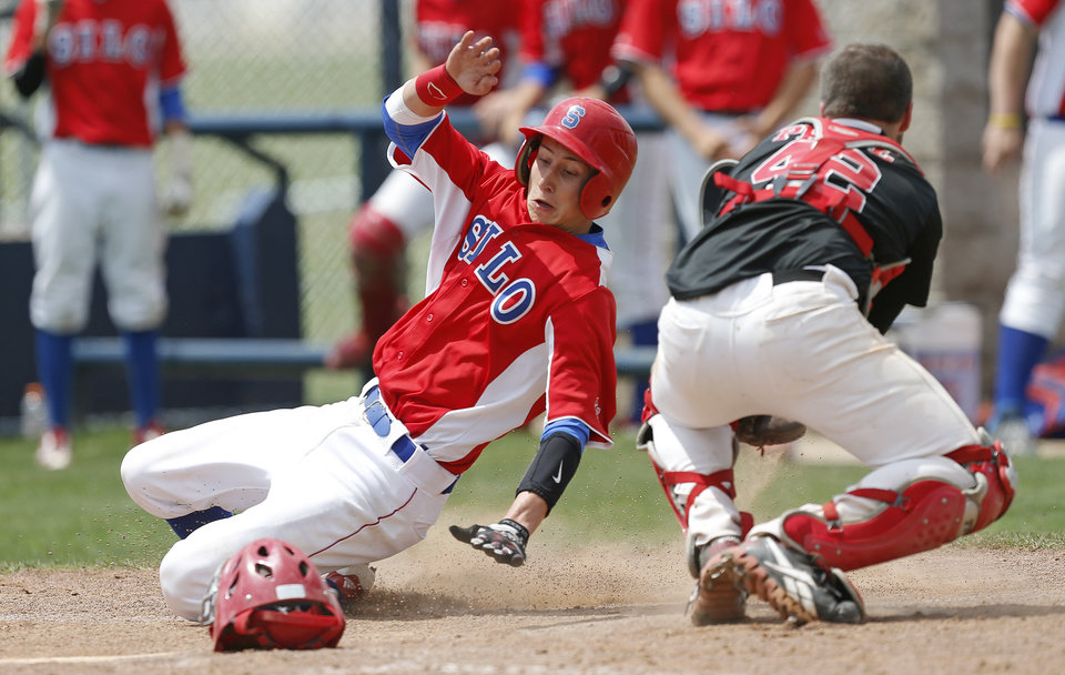 Silo's Andrew Bolin slides past Caney Valley's Caleb Pease to score in the third inning of  a Class 2A state baseball tournament game in Shawnee, Okla., Friday, May 10, 2013. Photo by Bryan Terry, The Oklahoman