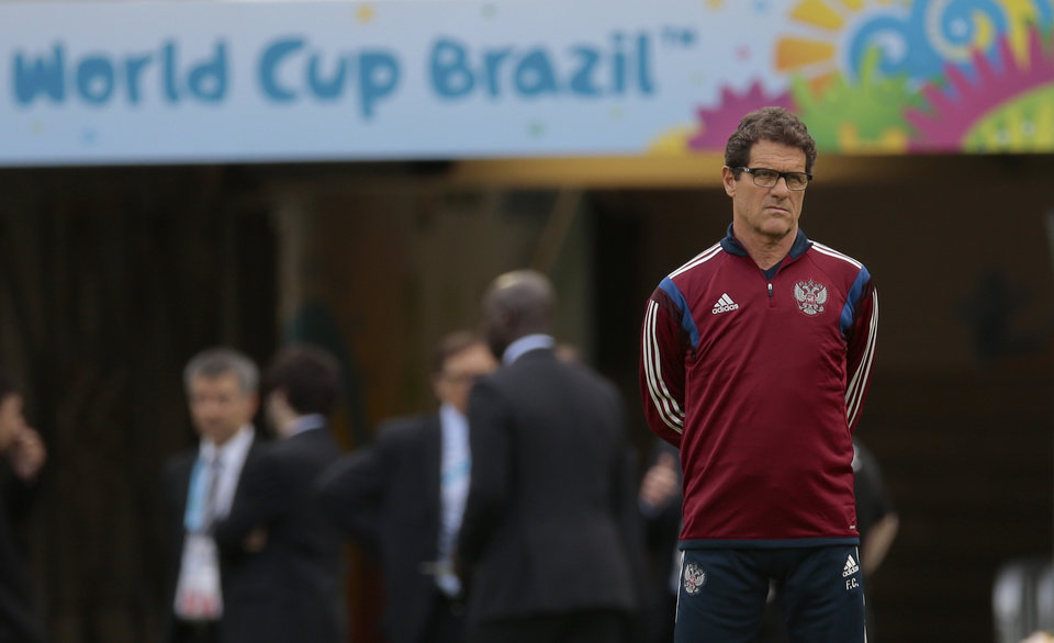 Photo - Fabio Capello, Italian coach of Russian national soccer team, watches his players during a training session at the Maracana stadium in Rio de Janeiro, Brazil, on Saturday, June 21, 2014. Russia will play next game against Belgium in group H of the 2014 soccer World Cup. (AP Photo/Ivan Sekretarev)