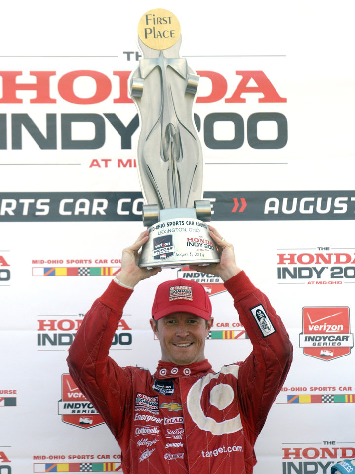 Photo - Scott Dixon, of New Zealand, celebrates in victory lane after winning the IndyCar Honda Indy 200 auto racing at Mid-Ohio Sports Car Course in Lexington, Ohio Sunday, Aug. 3, 2014. (AP Photo/Tom E. Puskar)