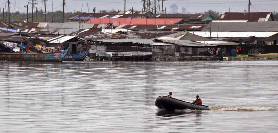 Photo - Liberian soldiers patrol the seaside of West Point by boat, an area that has been hit hard by the Ebola virus, with local residents not allowed to leave the West Point area,  as government forces clamp down on movement to prevent the spread of Ebola, in  Monrovia, Liberia, Wednesday, Aug. 27, 2014. Health officials in Liberia said the other two recipients of ZMapp in Liberia, a Congolese doctor and a Liberian physician's assistant, have recovered. Both are expected to be discharged from an Ebola treatment center on Friday, said Dr. Moses Massaquoi, a Liberian doctor with the treatment team. (AP Photo/Abbas Dulleh)