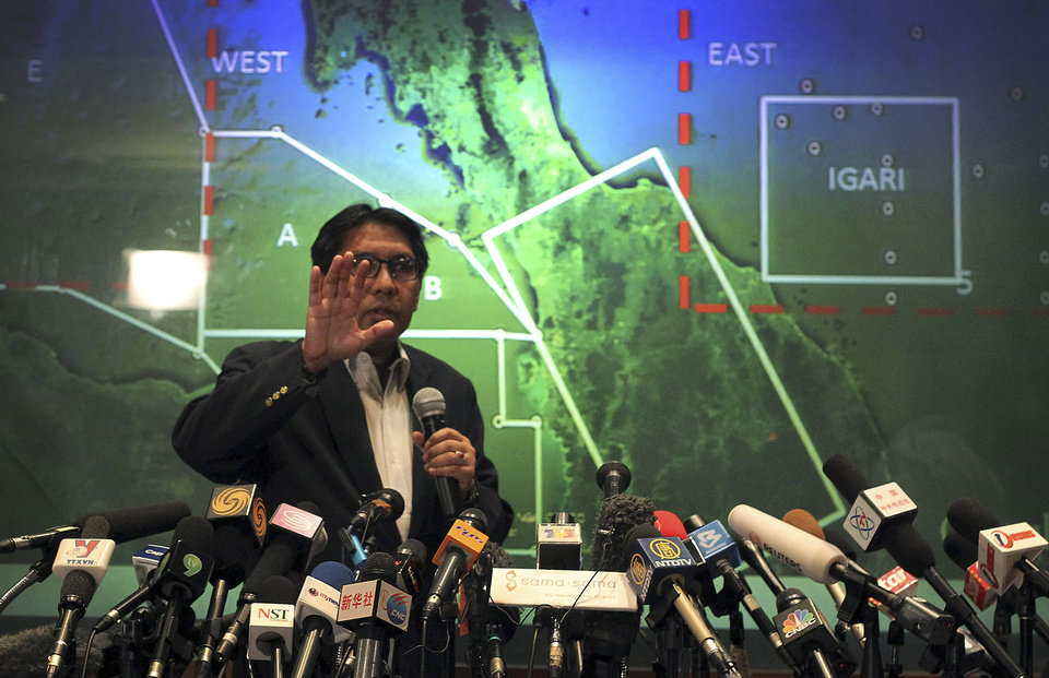 Photo - Malaysia's Department of Civil Aviation's Director General Azharuddin Abdul Rahman briefs reporters on search and recovery efforts within existing and new areas for missing Malaysia Airlines plane during a press conference, Monday, March 10, 2014 in Sepang, Malaysia. The search operation for the missing Malaysia Airlines MH370 which has involved 34 aircraft and 40 ships from several countries covering a 50-nautical mile radius from the point the plane vanished from radar screens between Malaysia and Vietnam continues after its disappearance since Saturday. Experts say possible causes of the apparent crash include an explosion, catastrophic engine failure, terrorist attack, extreme turbulence, or pilot error or even suicide. (AP Photo/Daniel Chan)