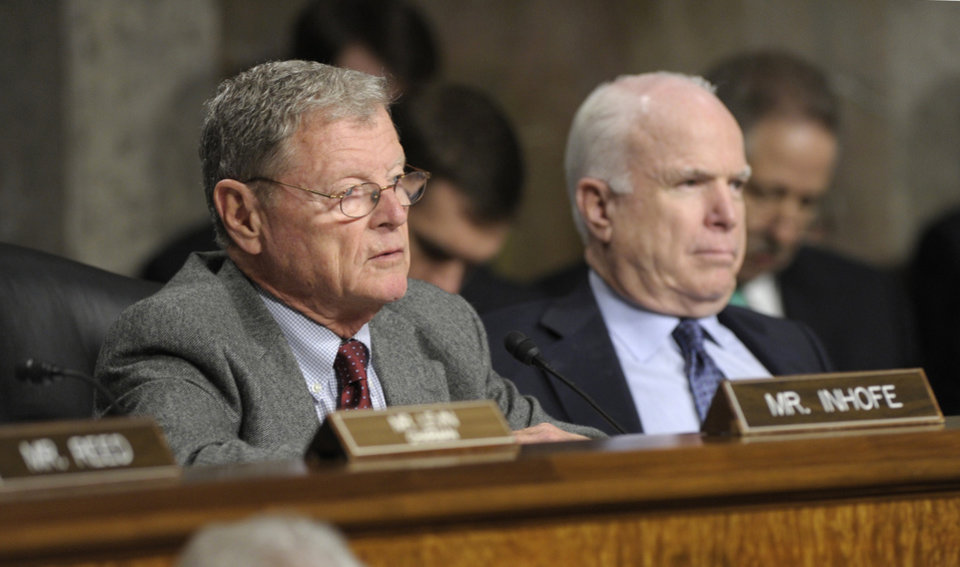 Senate Armed Services Committee members, Sen. James Inhofe, R-Okla., the committee's ranking Republican, left, accompanied by fellow committee member, Sen. John McCain, R-Ariz., asks a question of former Nebraska Republican Sen. Chuck Hagel, President Barack Obama's choice for defense secretary, on Capitol Hill in Washington, Thursday, Jan. 31, 2013, during the committee's hearing on his nomination.  (AP Photo/Susan Walsh)