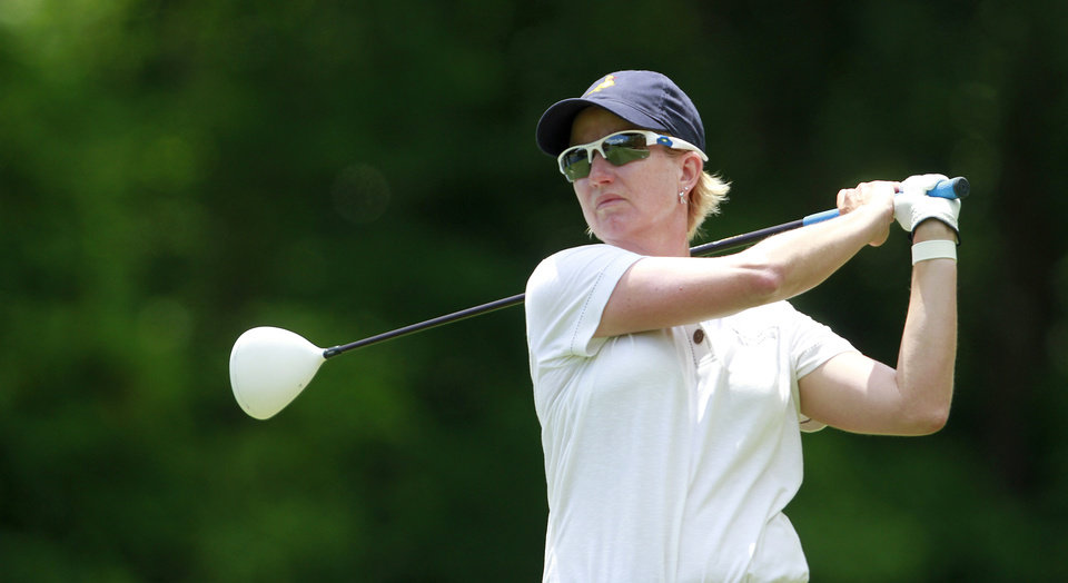 Photo -   Karrie Webb, of Australia, tees off on the ninth hole during the third round of the Mobile Bay LPGA Classic golf tournament, Saturday, April 28, 2012, in Mobile, Ala. (AP Photo/Press-Register, Bill Starling) MAGS OUT