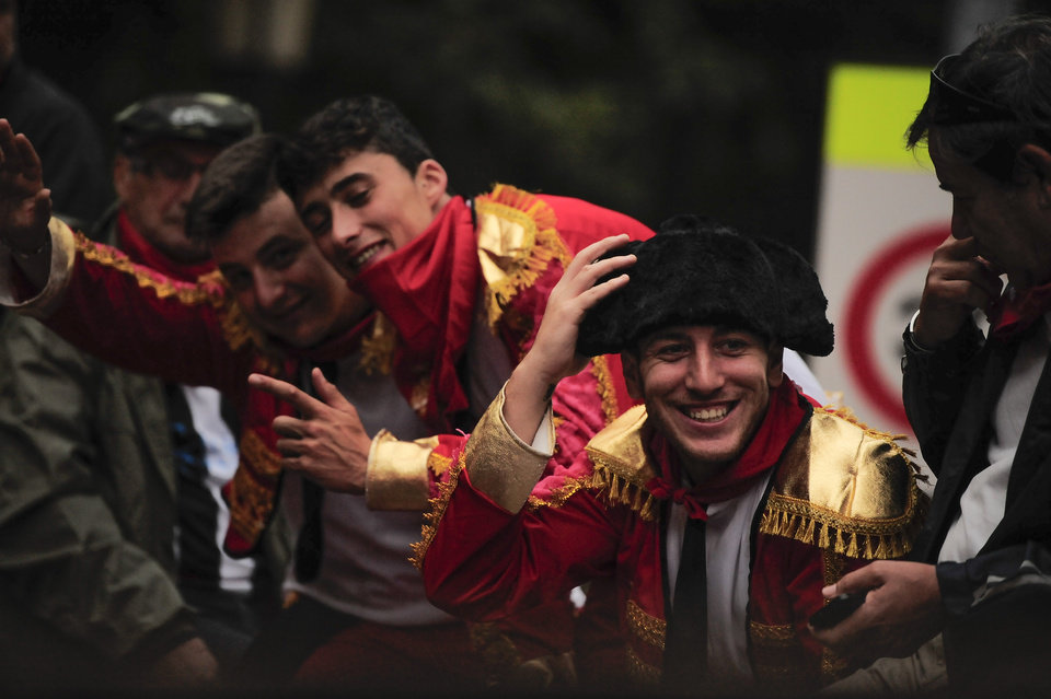 Photo - Revelers dressing as bullfighter, wait to start the running of the bulls, at the San Fermin festival, in Pamplona, Spain, Thursday, July 10, 2014. Revelers from around the world arrive to Pamplona every year to take part in some of the eight days of the running of the bulls glorified by Ernest Hemingway's 1926 novel