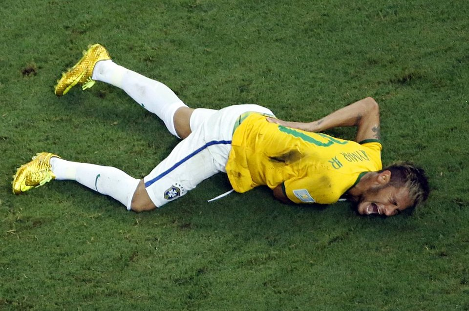 Photo - Brazil's Neymar grimaces in pain during the World Cup quarterfinal soccer match between Brazil and Colombia at the Arena Castelao in Fortaleza, Brazil, Friday, July 4, 2014. Brazil's team doctor says Neymar will miss the rest of the World Cup after breaking a vertebrae during the team's quarterfinal win over Colombia. (AP Photo/Fabrizio Bensch, Pool)