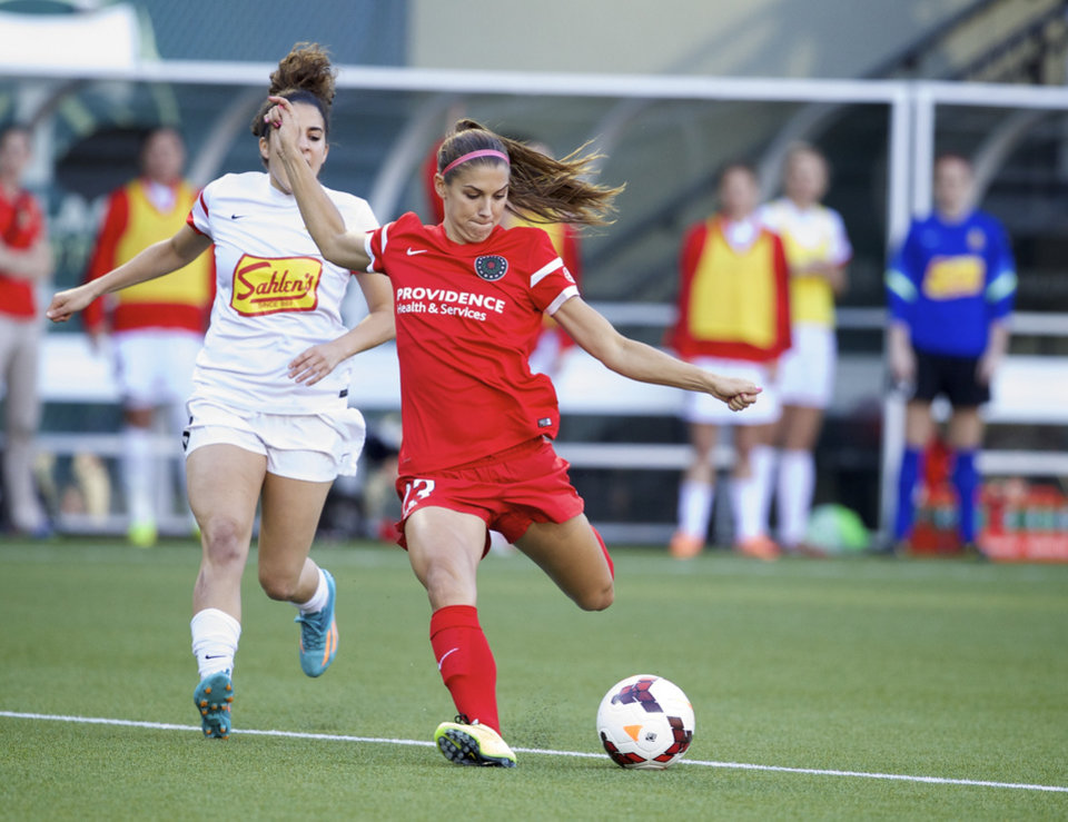 Photo - The Portland Thorns Alex Morgan (13), playing for the first time this season, prepares to fire a shot though the Thorns to fall behind the Western NY Flash, 4-0, at the end of the first half at Providence Park Saturday night June 7, 2014 in Portland.  (AP Photo/The Oregonian, Randy L. Rasmussen)
