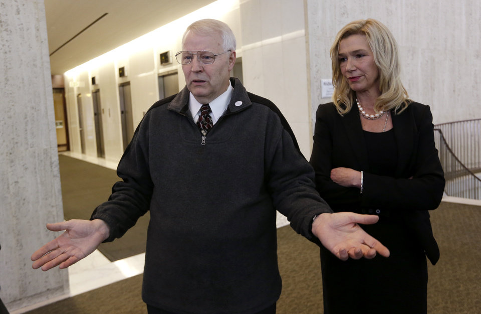 Photo - Chuck Cox, left, motions as he describes the search for his missing daughter as he stands with attorney Anne Bremner during a news conference Tuesday, May 21, 2013, in Seattle. Bremner said Tuesday there's an ongoing federal investigation into Susan Powell's disappearance. She made the announcement at the Seattle news conference a day after local officials in Utah said they had closed their investigation into the Susan Powell case. (AP Photo/Elaine Thompson)
