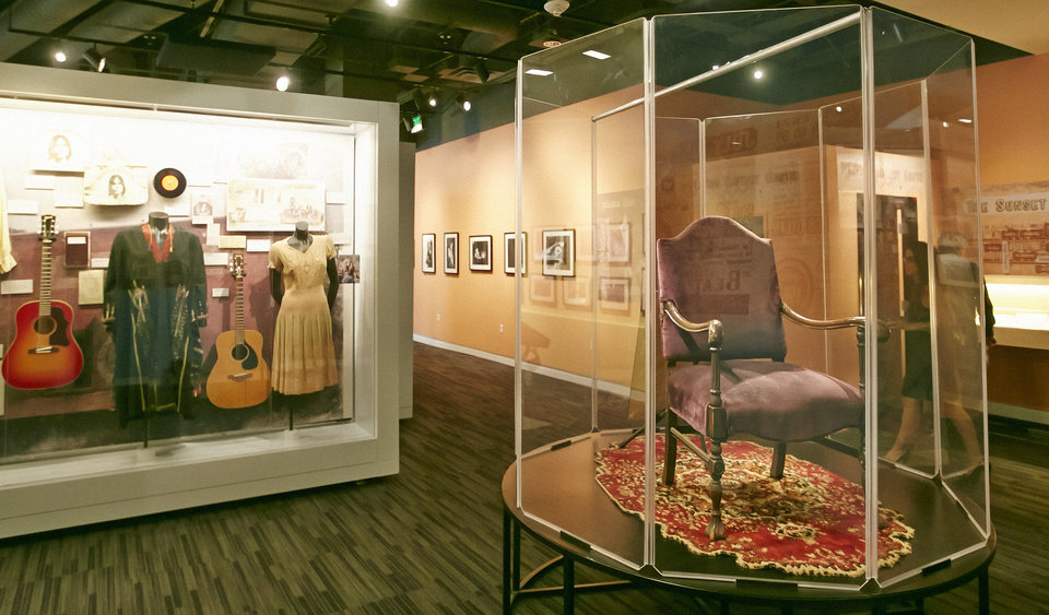 Photo - In this Friday, May 9, 2014 photo, Jim Morrison's chair is diplayed among other memorabilia at the Grammy Museum exhibit