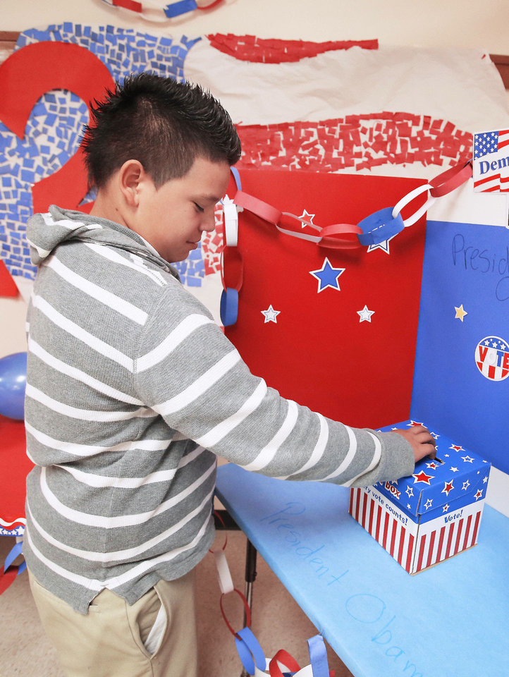 Photo - Capitol Hill Elementary student Jesus Juarez cast his vote in Oklahoma City, Wednesday October 31, 2012. Photo By Steve Gooch, The Oklahoman