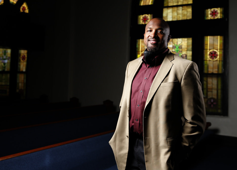 Photo - The Rev. Robert Turner poses for a photograph at the Vernon A.M.E Church in the Greenwood district in Tulsa, Okla., Wednesday, July 22, 2020. Photo by Sarah Phipps, The Oklahoman