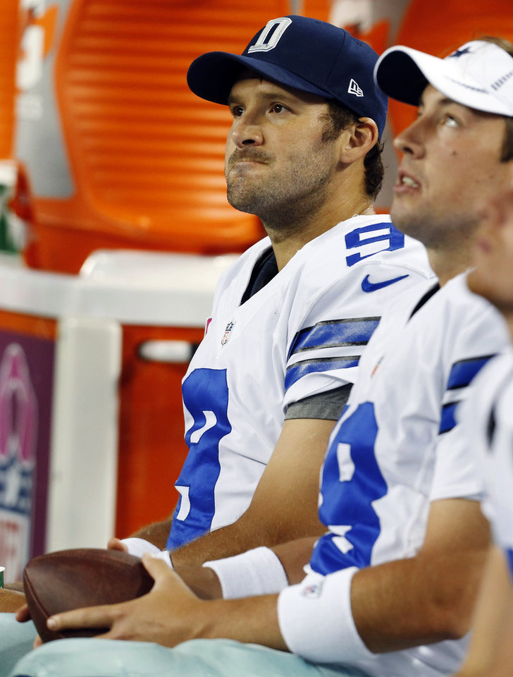Photo -   Dallas Cowboys quarterback Tony Romo (9) sits on the bench with quarterback Kyle Orton (18) after throwing an interception to Chicago Bears outside linebacker Lance Briggs during the second half of an NFL football game, Monday, Oct. 1, 2012 in Arlington, Texas. The Bears won 34-18. (AP Photo/Sharon Ellman)