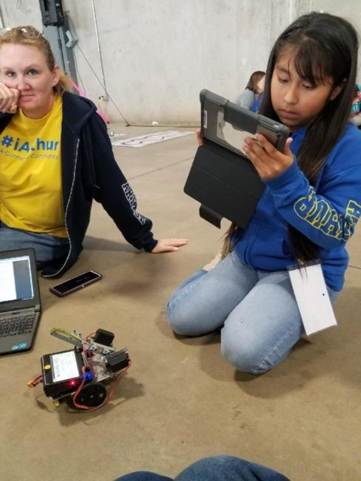 Photo -  Teacher Chantel Jones and student April Jose-Celaya from Arthur Elementary work together during a junior botball challenge. [Photo provided by Oklahoma City Public Schools]