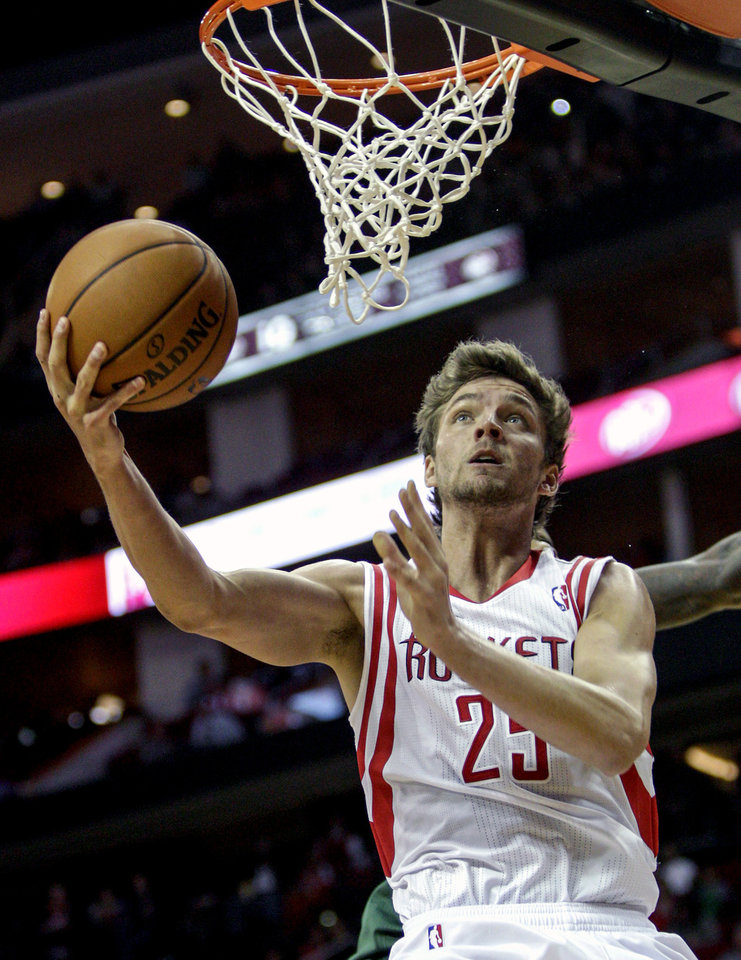 Houston Rockets forward Chandler Parsons (25) drives for a layup against the Milwaukee Bucks during the second half of an NBA basketball game, Wednesday, Feb. 27, 2013 in Houston. Milwaukee won 110-107. (AP Photo/Bob Levey)