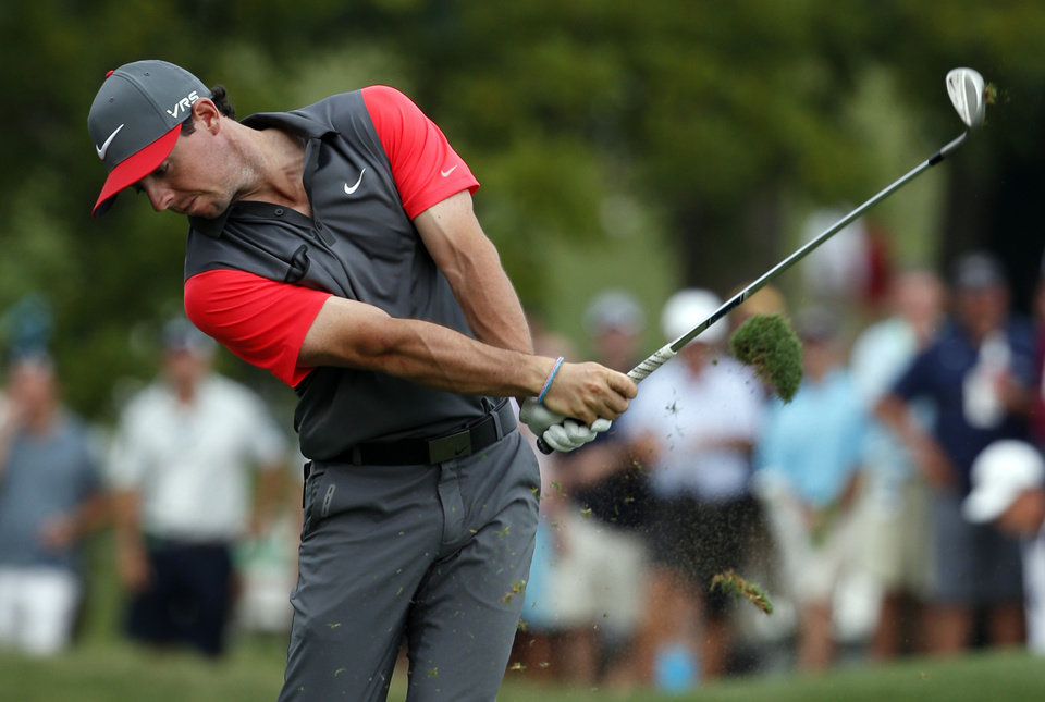 Photo - Rory McIlroy, of Northern Ireland, hits from the fairway on the 18th hole during the first round of the PGA Championship golf tournament at Valhalla Golf Club on Thursday, Aug. 7, 2014, in Louisville, Ky. (AP Photo/Mike Groll)