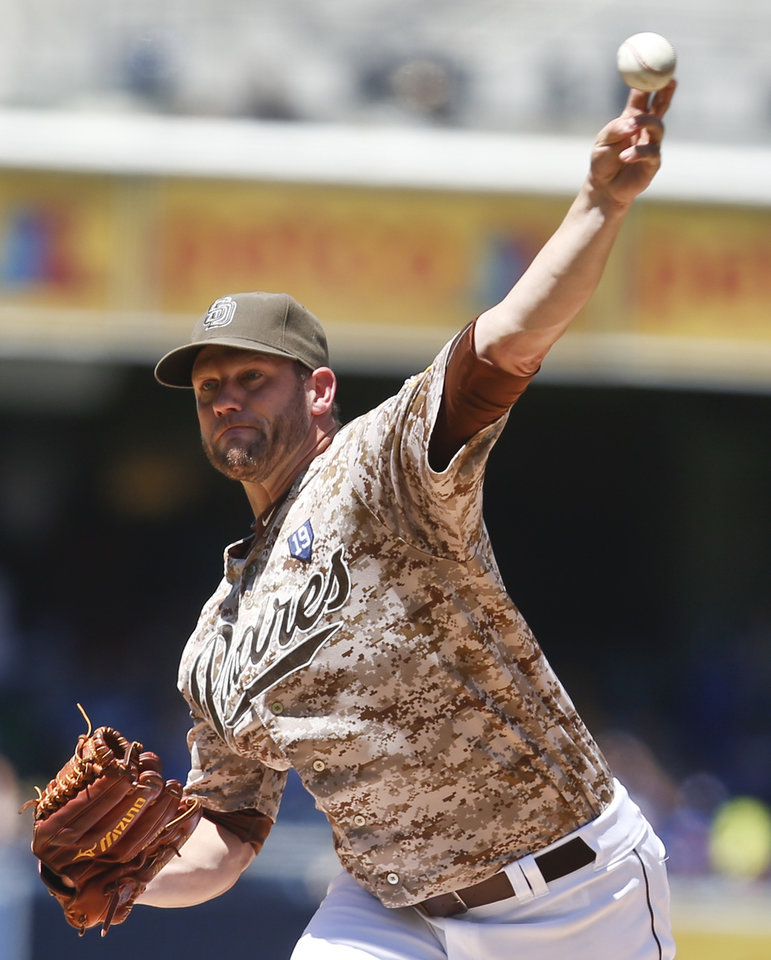 Photo - San Diego Padres starting pitcher Eric Stults throws to the Los Angeles Dodgers in the first inning of a baseball game Sunday, Aug. 31, 2014, in San Diego.  (AP Photo/Lenny Ignelzi)