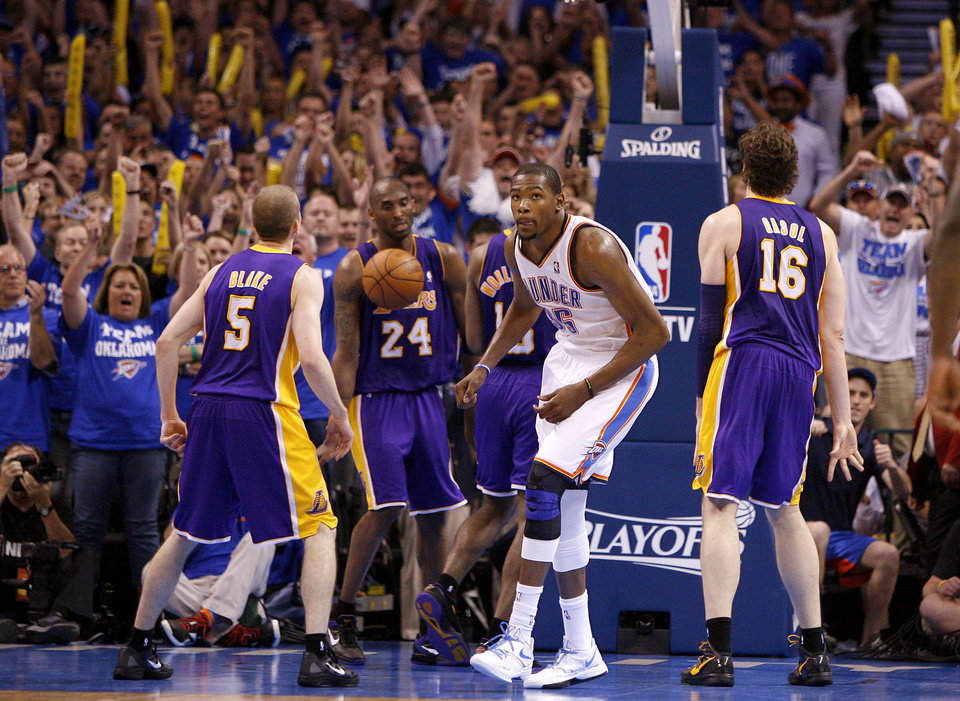 Photo - The crowd reacts after Oklahoma City's Kevin Durant (35) made a basket in the final seconds of Game 2 in the second round of the NBA playoffs between the Oklahoma City Thunder and L.A. Lakers at Chesapeake Energy Arena in Oklahoma City, Wednesday, May 16, 2012.  Oklahoma City won 77-75. Photo by Bryan Terry, The Oklahoman