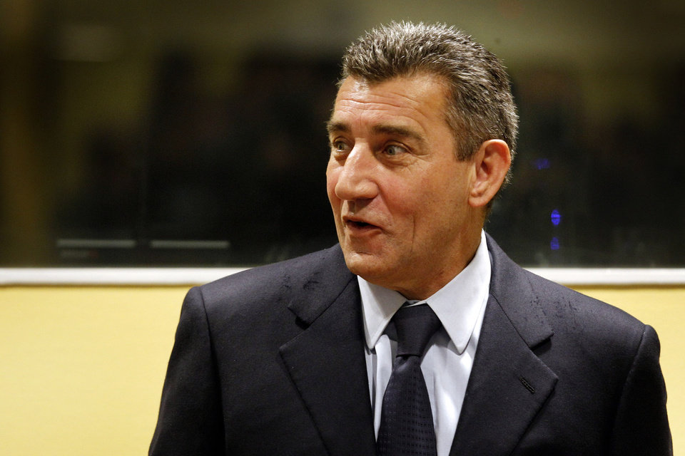 Photo -   Former Croatian Army General Ante Gotovina enters the courtroom of the Yugoslav war crimes tribunal (ICTY) for his appeal judgement in The Hague, Netherlands, Friday, Nov. 16, 2012. The ICTY is delivering its decision in the appeal of two Croatian generals convicted for their roles in a 1995 military offensive to drive Serb rebels out of land they had occupied for years along part of Croatia's border with Bosnia. Ante Gotovina and Mladen Markac, were sentenced to 24 and 18 years respectively in 2011 for war crimes and crimes against humanity. (AP Photo/Bas Czerwinski, Pool)