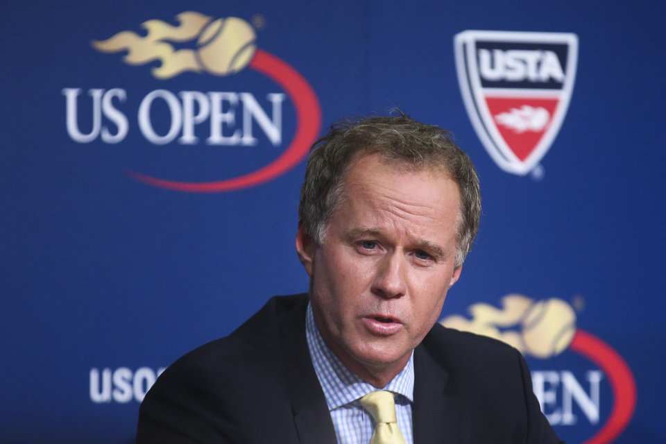 Photo - Patrick McEnroe announces his resignation as the U.S. Tennis Association's general manager of player development, at a news conference at the U.S. Open, Wednesday, Sept. 3, 2014, in New York. The change comes during a tournament in which no American men reached the round of 16 for the second year in a row - something that, until 2013, had never happened at an event that began in 1881. (AP Photo/John Minchillo)