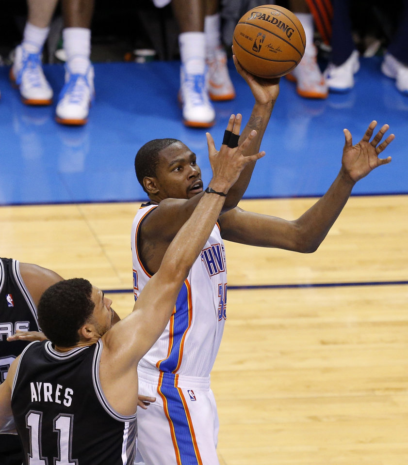 Photo - Oklahoma City's Kevin Durant (35) goes to the basket past San Antonio's Jeff Ayres (11) during Game 4 of the Western Conference Finals in the NBA playoffs between the Oklahoma City Thunder and the San Antonio Spurs at Chesapeake Energy Arena in Oklahoma City, Tuesday, May 27, 2014. Photo by Bryan Terry, The Oklahoman