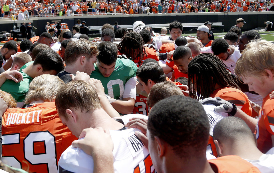 Photo - The Cowboys huddle following the Oklahoma State University Spring football game at Boone Pickens Stadium in Stillwater, Okla., Saturday, April, 18, 2015. Photo by Sarah Phipps, The Oklahoman