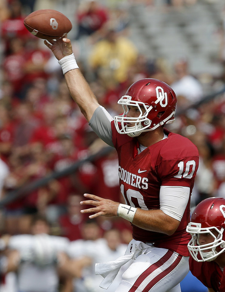Oklahoma's Blake Bell (10) throws a pass during a college football game between the University of Oklahoma Sooners (OU) and the Tulsa Golden Hurricane at Gaylord Family-Oklahoma Memorial Stadium in Norman, Okla., on Saturday, Sept. 14, 2013. Oklahoma won 51-20. Photo by Bryan Terry, The Oklahoman