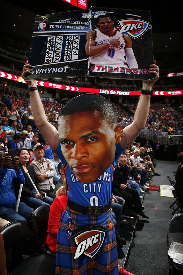 Photo - An Oklahoma City Thunder fan wears a Russell Westbrook Fat Head after Westbrook set a new NBA record for triple doubles with 42 for the season against the Denver Nuggets Sunday, April 9, 2017, in Denver. Oklahoma City beat Denver 106-105. (AP Photo/Jack Dempsey)