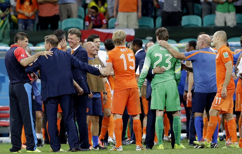 Photo - Netherlands' head coach Louis van Gaal, fourth from left, celebrates with his team after a World Cup quarterfinal soccer match between the Netherlands and Costa Rica at the Arena Fonte Nova in Salvador, Brazil, Saturday, July 5, 2014. The Netherlands won 4-3 on penalty kicks. (AP Photo/Hassan Ammar)