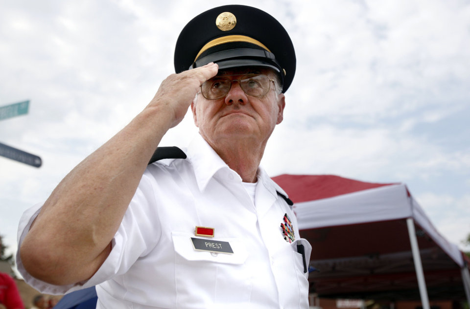 Photo - Retired Oklahoma National Guard Staff Sgt. Robert Prest salutes the flag during the LibertyFest Parade in Edmond, Okla., Monday, July 4, 2011. Photo by Sarah Phipps, The Oklahoman