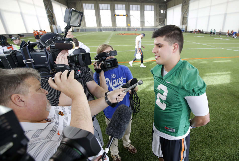 Photo -  Oklahoma State quarterback Mason Rudolph, right, talks with reporters on Monday before the Cowboys' first spring football practice. [PHOTO BY STEVE GOOCH, THE OKLAHOMAN]