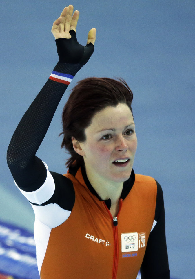 Photo - Jorien ter Mors of the Netherlands acknowledges the crowd after setting a new Olympic record in the women's 1,500-meter race at the Adler Arena Skating Center during the 2014 Winter Olympics in Sochi, Russia, Sunday, Feb. 16, 2014. (AP Photo/David J. Phillip )