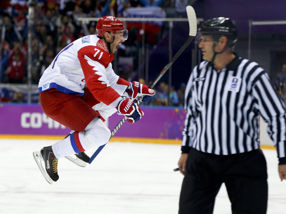 Photo - Russia forward Ilya Kovalchuk reacts after scoring a goal against Finland during the first period of a men's quarterfinal ice hockey game at the 2014 Winter Olympics, Wednesday, Feb. 19, 2014, in Sochi, Russia. (AP Photo/Julio Cortez)