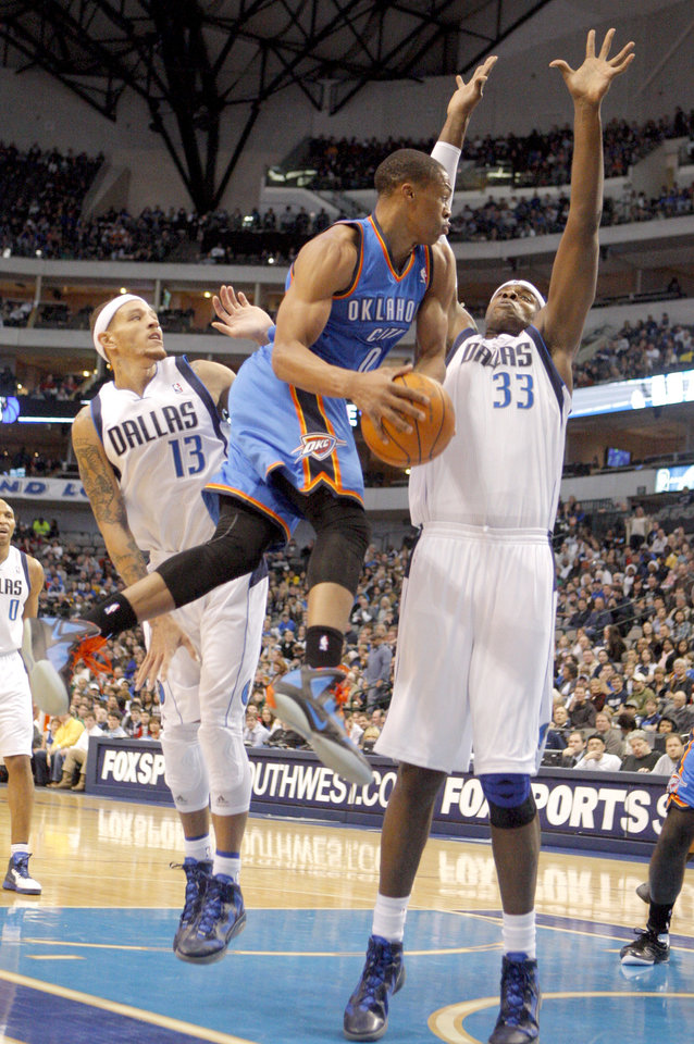 Photo - NBA BASKETBALL / DALLAS MAVERICKS: Oklahoma City's Russell Westbrook (0) shoots a layup as Dallas' Brendan Haywood (33) defends  during the preseason NBA game between the Dallas Mavericks and the Oklahoma City Thunder at the American Airlines Center in Dallas, Sunday, Dec. 18, 2011. Photo by Sarah Phipps, The Oklahoman