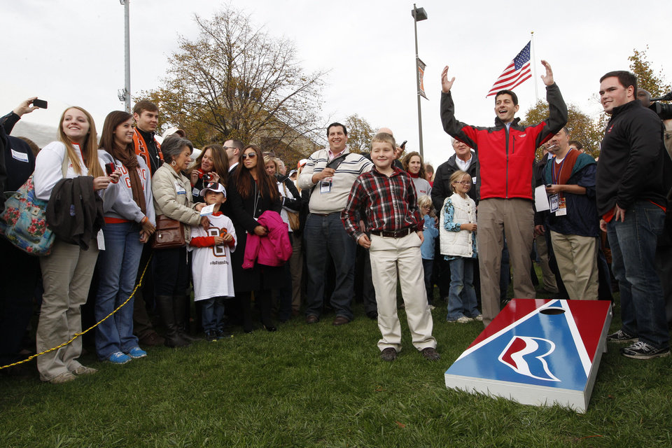 "Republican vice presidential candidate, Rep. Paul Ryan, R-Wis., and his son Charlie, center, play ""cornhole"" at a Bowling Green State University and Miami University of Ohio football game tailgate party, Saturday, Oct. 13, 2012 in Bowling Green, Ohio. (AP Photo/Mary Altaffer)"