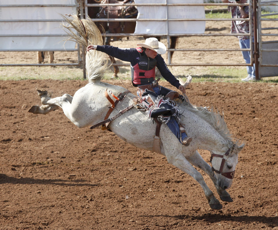 Photo - Preston Burr, from Stratford, TX, competes in the Saddle Bronc event during Tuesday's performances at the International Youth Finals Rodeo at the Shawnee Heart of Oklahoma Exposition Center in Shawnee, OK, Tuesday, July 8, 2014,  Photo by Paul Hellstern, The Oklahoman