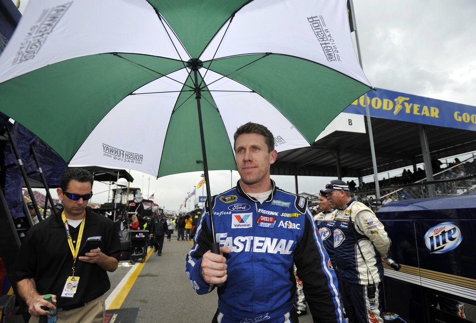 Photo - Carl Edwards walks down pit road as the leader during a rain delay in the NASCAR Sprint Cup Series Aaron's 499 auto race at Talladega Superspeedway in Talladega, Ala., Sunday, May 5, 2013. (AP Photo/Rainier Ehrhardt)