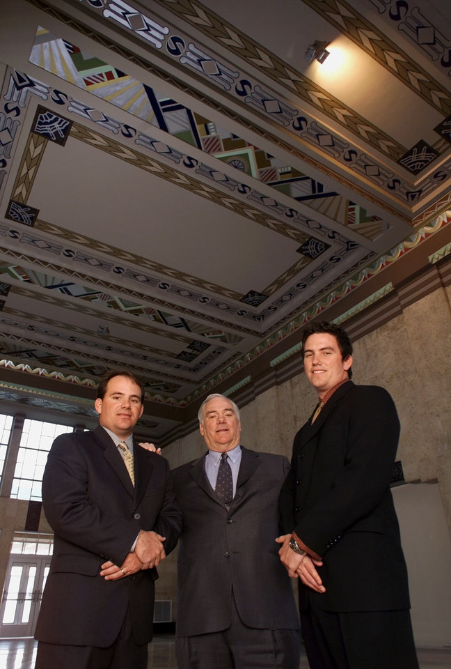 Photo - RESTORE, RESTORATION, BRENT BREWER, BRETT BREWER: Bricktown developer Jim Brewer (center) with sons Brent (left) and Brett (right) in the old Santa Fe Train Depot at 100 S. E.K. Gaylord Blvd. in downtown OKC. Brewer is restoring old train depot as part of Bricktown area business resurgence. Original depot floor has been uncovered and restored, as has the original ceiling.  Staff Photo by Roger Klock