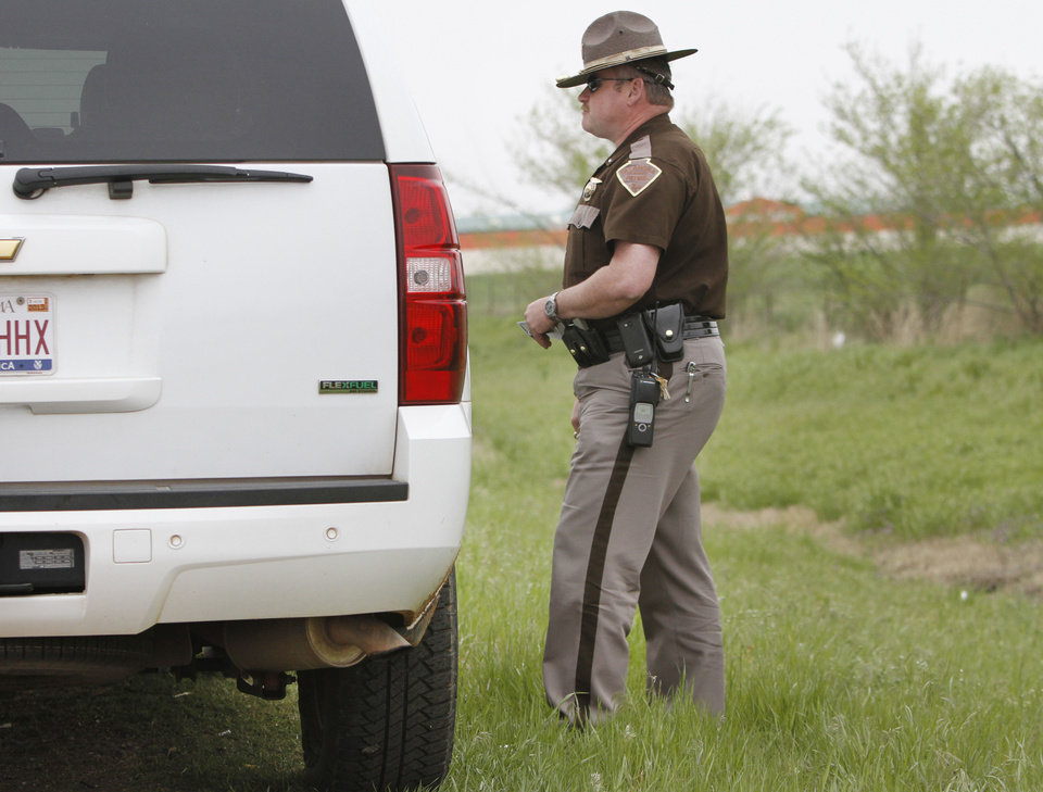 Photo - Lt. Mark Reynolds, with the Oklahoma Highway Patrol, gives a warning to a motorist who was following to closely April 16 on Interstate 40 in Oklahoma City. Photo By Steve Gooch, The Oklahoman  Steve Gooch