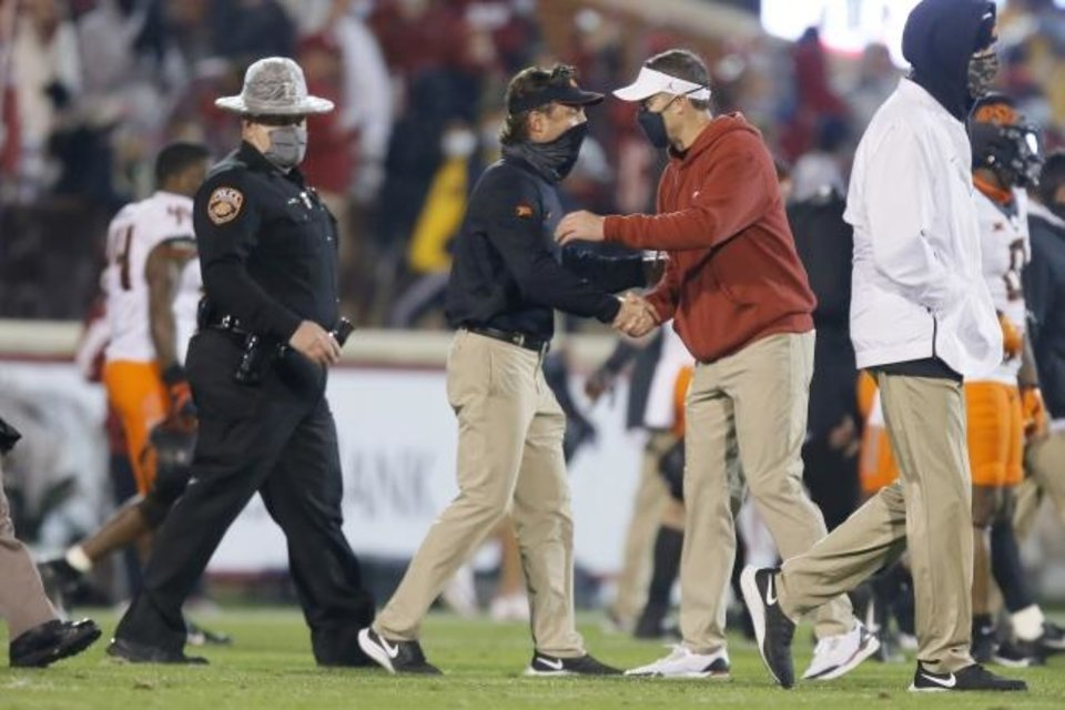 Photo -  Oklahoma coach Lincoln Riley, right, greets Oklahoma State coach Mike Gundy after a bedlam college football game between the University of Oklahoma Sooners (OU) and the Oklahoma State Cowboys (OSU) at Gaylord Family-Oklahoma Memorial Stadium in Norman, Okla., Saturday, Nov. 21, 2020. Oklahoma won 41-13. [Bryan Terry/The Oklahoman]