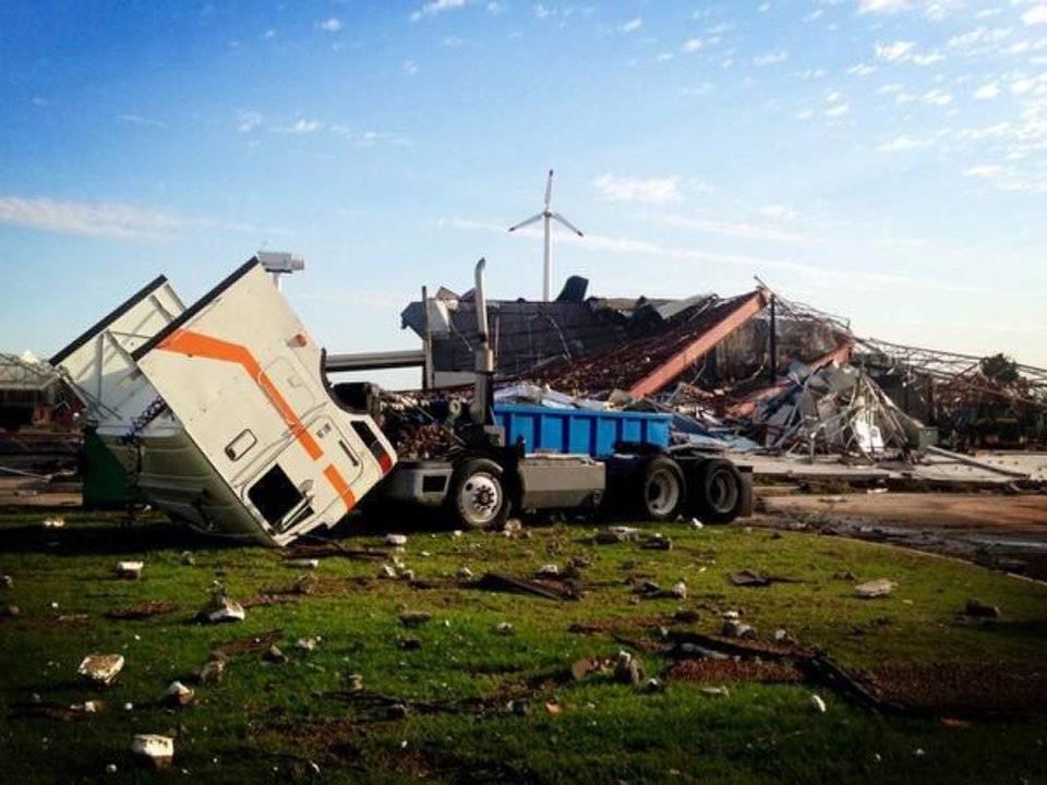 Photo - A maintenance building at Canadian Valley Technology Center in El Reno is shown in the days following the May 31, 2013, tornado that hit the school.  A wind tower used for training is shown in the background. It sustained minor damage from flying debris.  PHOTO PROVIDED