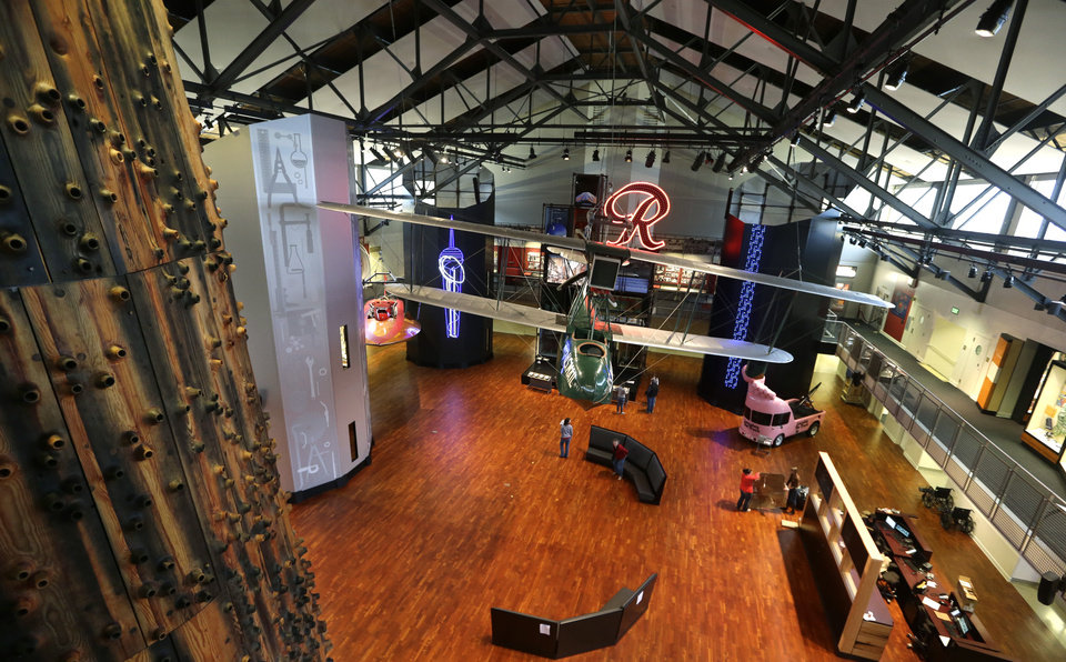Photo - This photo taken Wednesday, Dec. 26, 2012 shows the Faye G. Allen Grand Atrium at Seattle's Museum of History and Industry in the city's South Lake Union neighborhood. The atrium features a 1919 Boeing B-1 floatplane suspended from the ceiling.