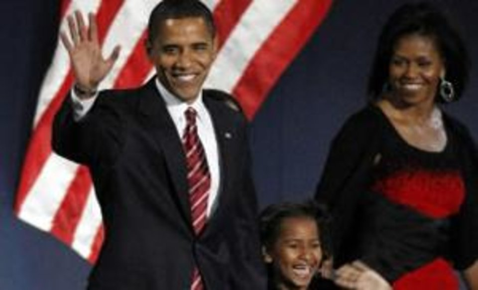 Photo - President-elect Barack  Obama, his wife Michelle and daughter Sasha, 7, wave as they take the stage at his election night party at Grant Park in Chicago, Tuesday night, Nov. 4, 2008. (AP Photo/Pablo Martinez Monsivais)