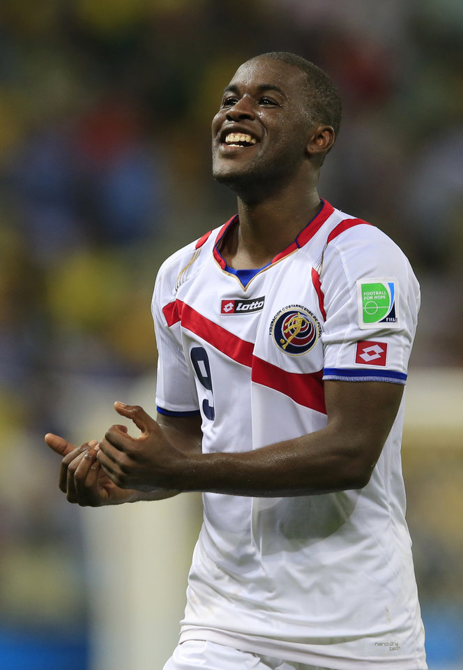 Photo - Costa Rica's Joel Campbell celebrates after the group D World Cup soccer match between Uruguay and Costa Rica at the Arena Castelao in Fortaleza, Brazil, Saturday, June 14, 2014.  Costa Rica won the match 3-1.  (AP Photo/Bernat Armangue)