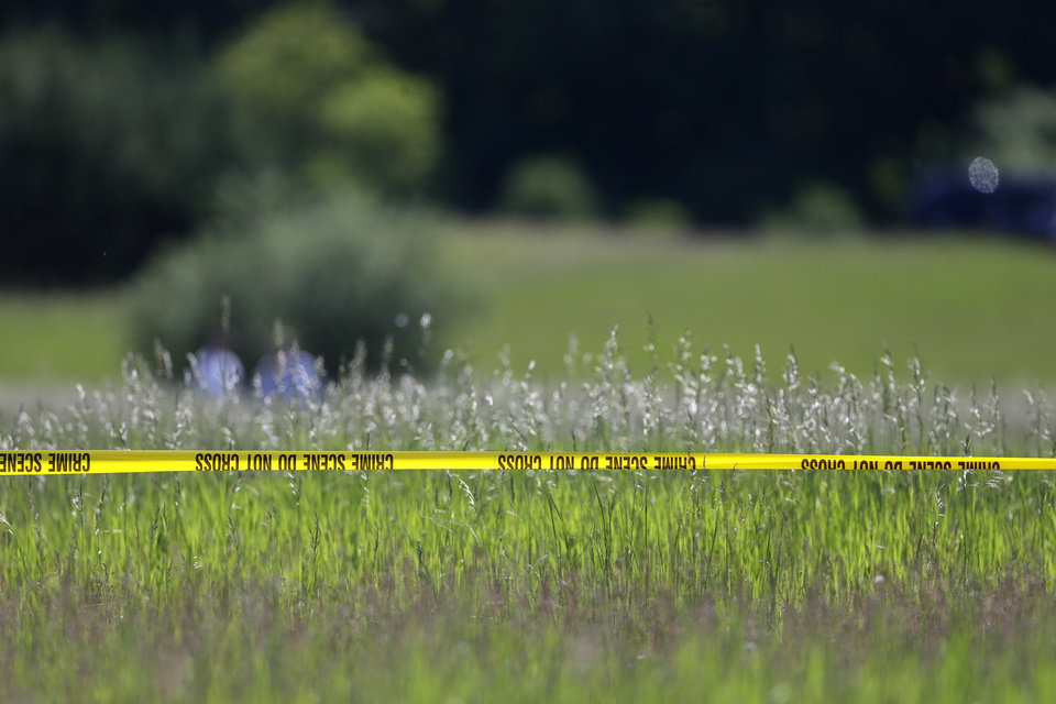 Crime scene tape surrounds the scene in Oakland Township, Mich., Monday, June 17, 2013 where officials search for the remains of Teamsters union president Jimmy Hoffa who disappeared from a Detroit-area restaurant in 1975. (AP Photo/Carlos Osorio)