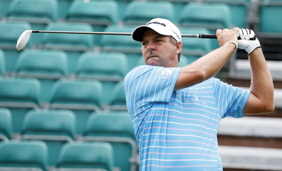 Photo - Dicky Pride grimaces as he watches his tee shot  at the first hole of the first round of the Sanderson Farms Championship golf tournament, Thursday, July 18, 2013 in Madison, Miss. (AP Photo/Rogelio V. Solis)