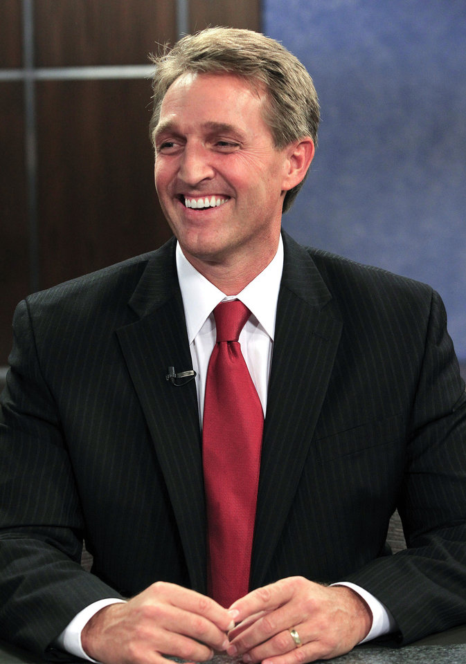 Rep. Jeff Flake, R-Ariz., smiles in studio prior to an Arizona U.S. Senate debate against Democrat Richard Carmona and Libertarian Marc Victor, Wednesday, Oct. 10, 2012, in Phoenix. The candidates are vying for the seat left open by retiring Sen. Jon Kyl, R-Ariz. (AP Photo/Ross D. Franklin)