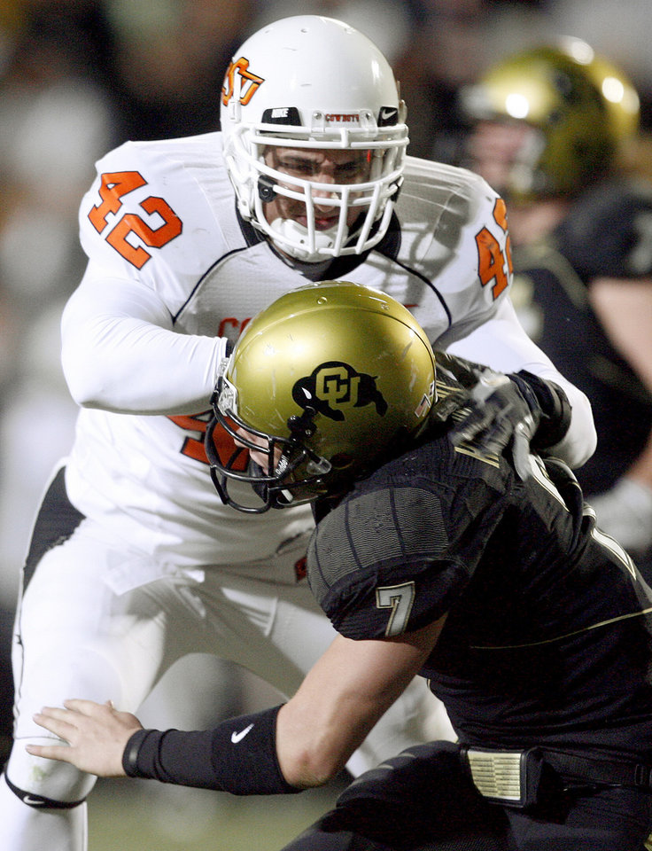 Photo - OSU's Justin Gent pushes Colorado's Cody Hawkins after a pass during the college football game between Oklahoma State University and the University of Colorado at Folsom Field in Boulder, Colo., Saturday, Nov. 15, 2008. BY BRYAN TERRY, THE OKLAHOMAN
